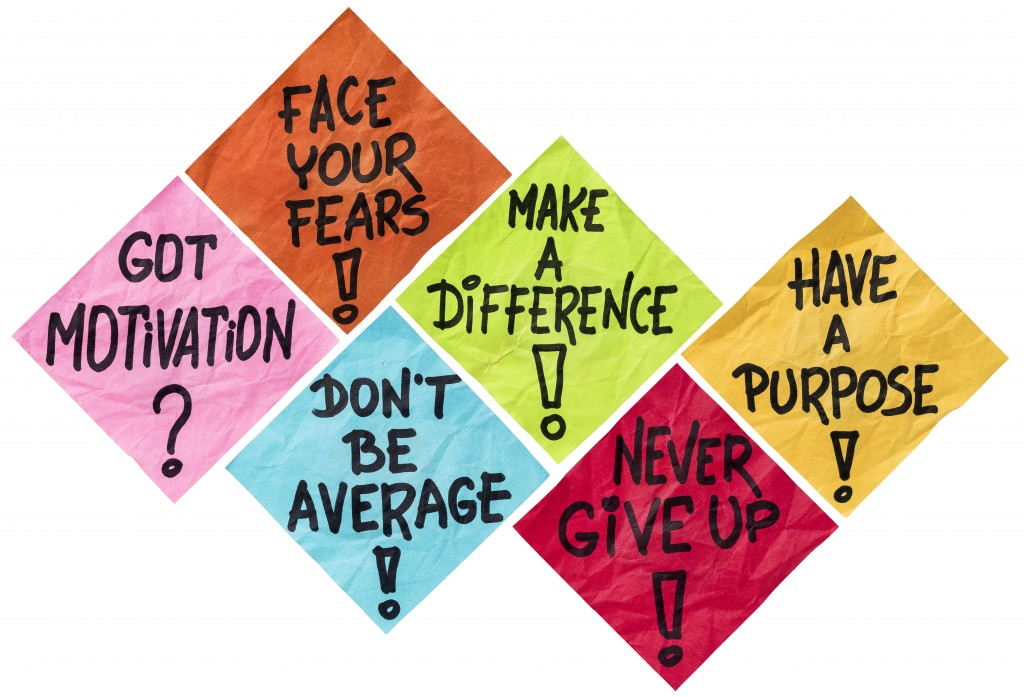 face your fears, make a difference, don't be average, never give up, have a purpose - motivation reminders - a set of isolated crumpled sticky notes in different colors